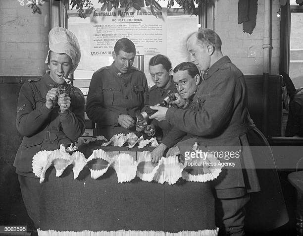 Australian soldiers with crackers and party blowers at the Anzac buffet