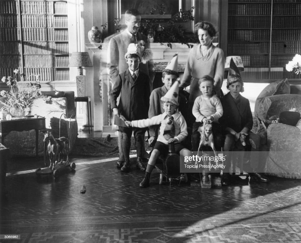 American born British politicians and husband and wife Waldorf Astor and Nancy Astor with their children at home
