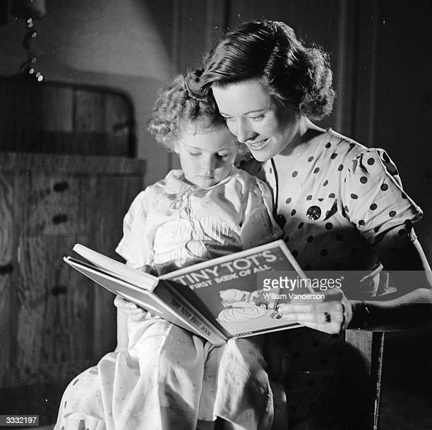 Model Vera Dunlop reads a bedtime story to her daughter