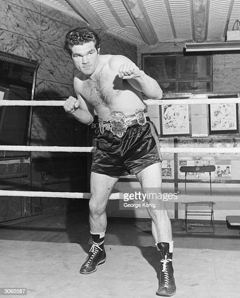 English boxing champion Freddie Mills winner of the 1948 World Light Heavyweight title keeps in shape at his London gymnasium wearing his...
