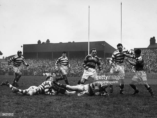 A player falls to the ground after a successful tackle during the Leigh versus Swinton rugby match played at Leigh in Lancashire Original Publication...