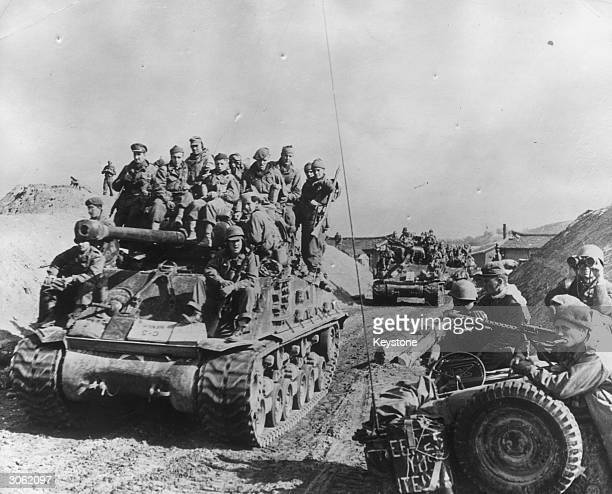 Soldiers of the 27th British Commonwealth Brigade on American tanks in Korea