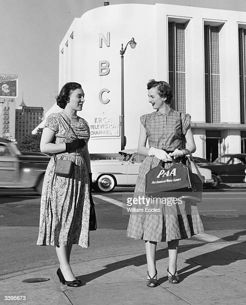 Marguerite and Joan telephonists at the London office of Pan American Airways outside the National Broadcasting Company's radio and television...