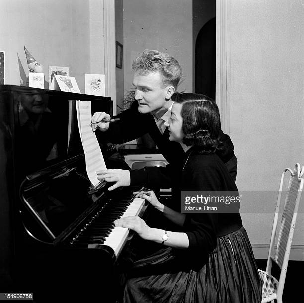 December 1956 John Albert has left 'The Companions of the song' to try a solo career With an unidentified person e accompanying on piano