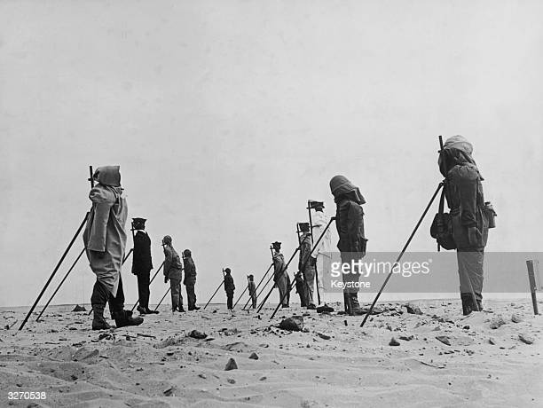 A set of dummies propped up in the Sahara Desert awaiting a third atomic bomb explosion during the French nuclear testing The third test codenamed...