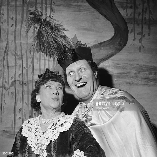 British comedian Tommy Cooper and Hylda Baker in costume as Abanezer and Widow Twanky for a London pantomime version of 'Aladdin'