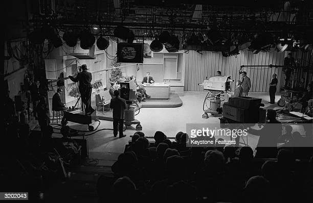 A view of the studio recording of NBC's 'Tonight' show with host Johnny Carson interviewing a guest