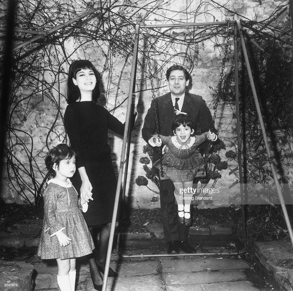 Conservative MP Nigel Lawson playing with his first wife Vanessa and two of their daughters. Nigella Lawson is the little girl on the swing.