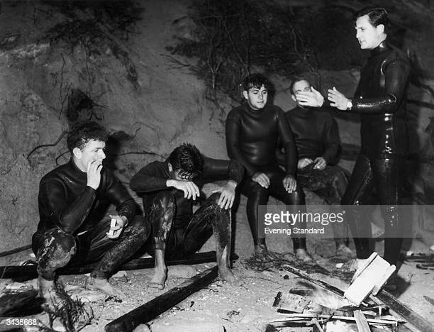 Divers take a break after unsuccesfully searching for the body of Australian prime minister Harold Holt who went missing while swimming at Portsea...