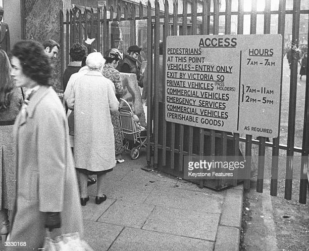 Residents of Belfast queuing up at a checkpoint leading out of the city's shopping area Such checkpoints enable British soldiers to search local...