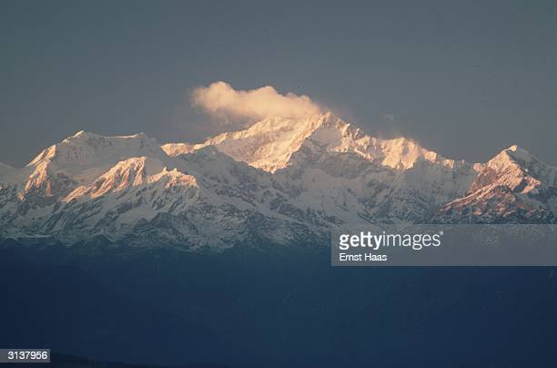 The snowy peaks of Kanchenjunga on the borders of Nepal and Sikkim as seen from Tiger Hill in Darjeeling Rising to a height of 28208 feet above sea...