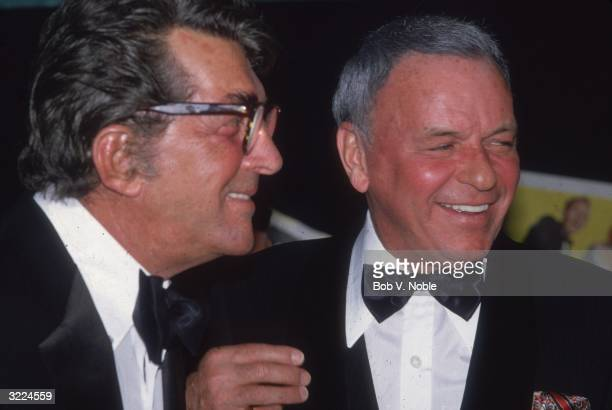 American actors and singers Frank Sinatra and Dean Martin smiling and looking off camera at Caesar's Palace Las Vegas Nevada Sinatra had received the...