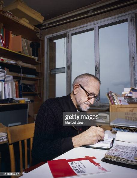 December 1985 CharentonlePont l'Abbe Pierre was sitting his desk taking notes in a notebook