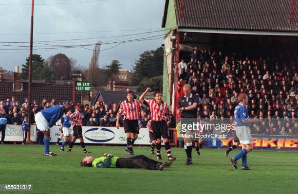 11 December 1999 FA Cup 3rd Round Football Exeter City v Everton The Exeter players protest to referee Steve Bennett after he allowed play to...