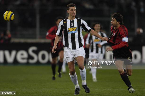 Zlatan Ibrahimovic of Juventus FC and Billy Costacurta of AC Milan compete for the ball during the italian Serie A 2004/2005 16 th round macht played...