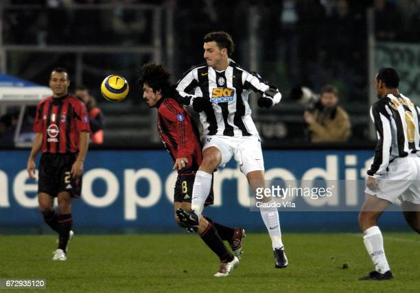 Zlatan Ibrahimovic of Juventus FC and Gennaro Gattuso of AC Milan compete for the ball during the italian Serie A 2004/2005 16 th round macht played...