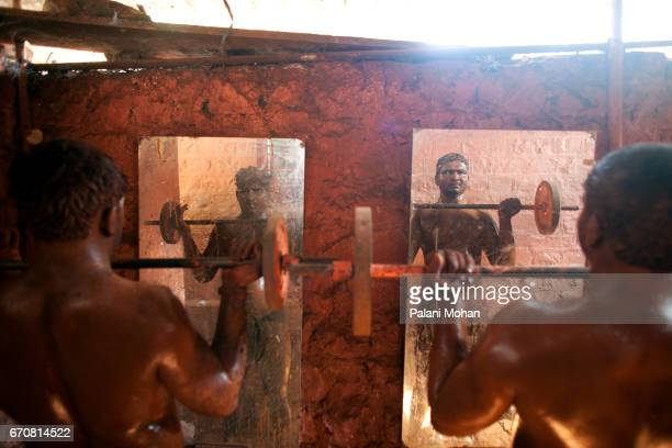 Kushti wrestlers training using weights at a Akhada or wrestling schools in the town of Kolhapur in India 13 December 2009 Kushti is an ancient...