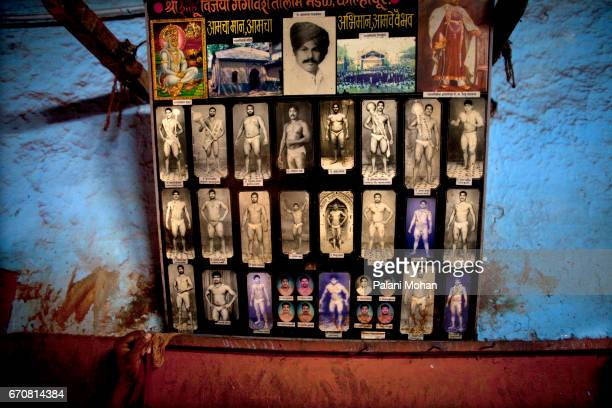 Portraits of former wrestling champions on a wall at a Akhada or wrestling schools in the town of Kolhapur in India 13 December 2009 Kushti is an...