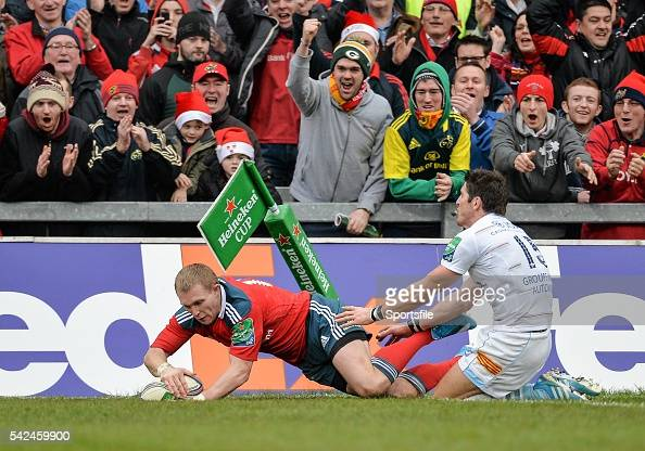 8 December 2013 Keith Earls Munster goes over to score his side's third try despite the tackle of James Hook Perpignan Heineken Cup 2013/14 Pool 6...