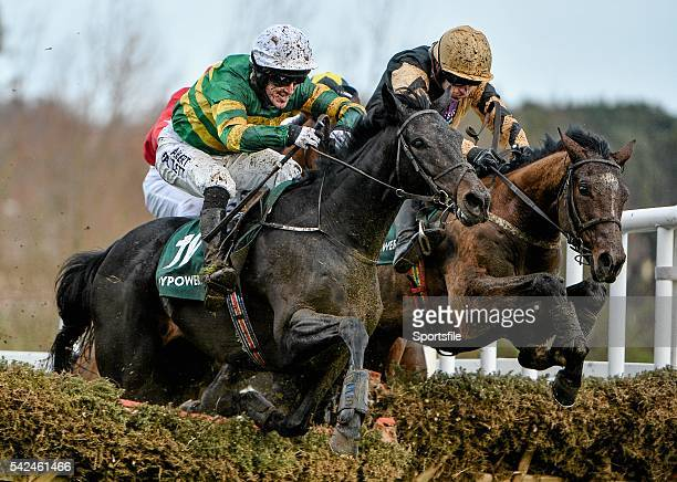 27 December 2013 Plinth left with Tony McCoy up jumps the last ahead of Ivan Grozny with Ruby Walsh up on their way to winning the The Paddy Power...