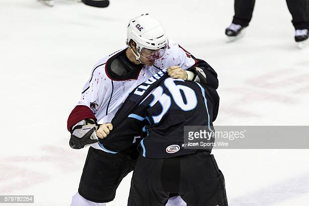 A bloody Lake Erie Monsters D Duncan Siemens and Milwaukee Admirals LW Richard Clune fight during the game between the Milwaukee Admirals and Lake...
