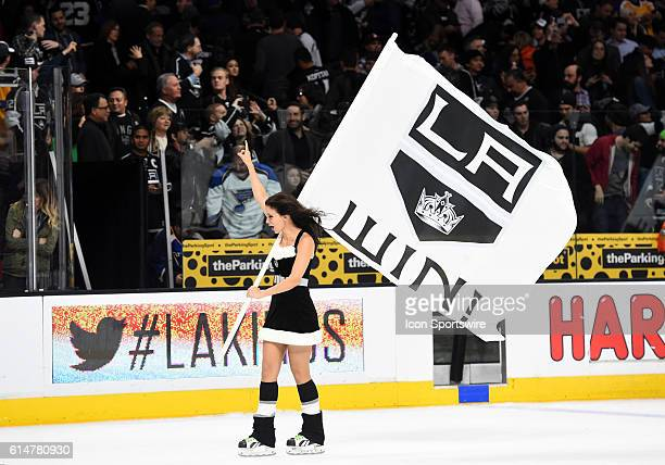 A member of the LA Kings Ice Crew holds up the LA Win banner during an NHL game between the St Louis Blues and the Los Angeles Kings at STAPLES...