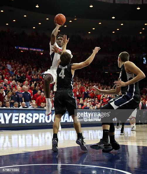 Arizona Wildcats forward Stanley Johnson drives on Gonzaga Bulldogs guard Kevin Pangos during the first half of the college basketball game between...