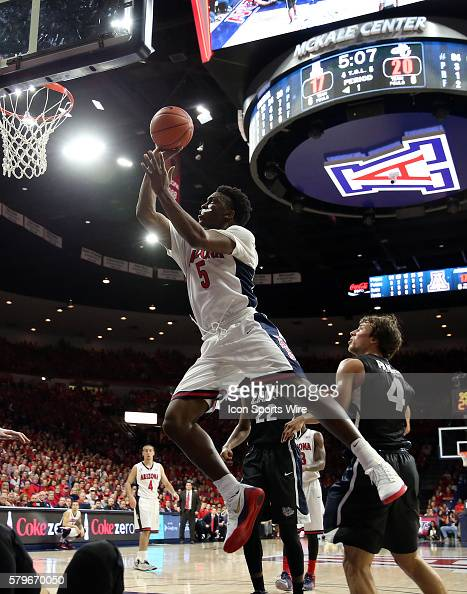 Arizona Wildcats forward Stanley Johnson drives over Gonzaga Bulldogs guard Kevin Pangos during the first half of the college basketball game between...