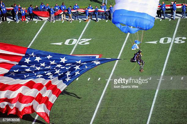 Double amputee Sergeant Major Dana Bowman parachutes on to the field in the Military Bowl at NavyMarine Corps Memorial Stadium in Annapolis MD