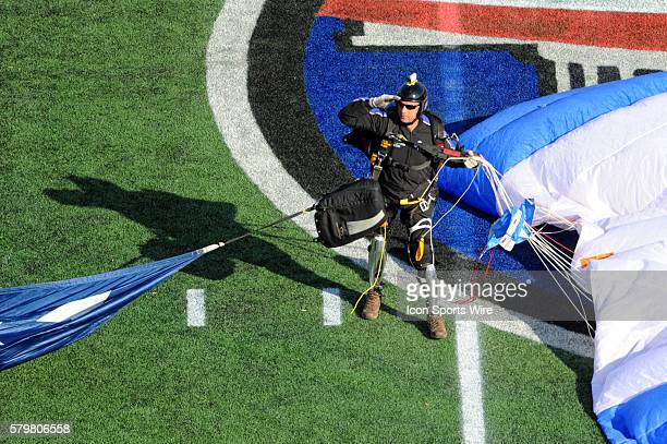 Double amputee Sergeant Major Dana Bowman salutes the crowd after parachuting on to the field in the Military Bowl at NavyMarine Corps Memorial...