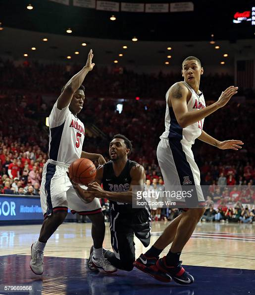 Gonzaga Bulldogs guard Byron Wesley drives between Arizona Wildcats forward Stanley Johnson and forward Brandon Ashley during the second half of the...