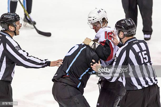 Linesmen Ray King and Linesmen Zach Roberts separate a bloody Lake Erie Monsters D Duncan Siemens and Milwaukee Admirals LW Richard Clune during the...