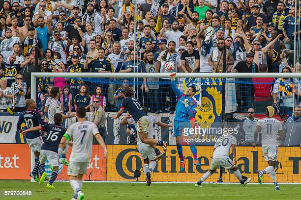 Los Angeles Galaxy goalkeeper Jaime Penedo punches away a header by New England Revolution midfielder Jermaine Jones during the MLS Cup between the...