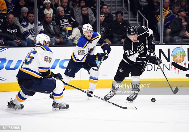 Los Angeles Kings Right Wing Tyler Toffoli [8400] maneuvers the puck around St Louis Blues Defenseman Chris Butler [5150] during an NHL game between...
