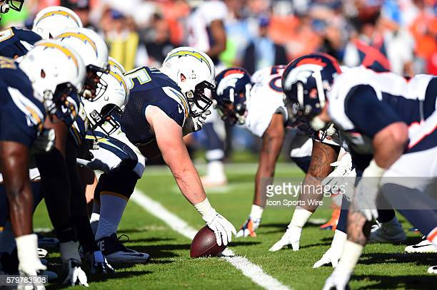 The Chargers offensive line and the Broncos defensive line set up and the line of scrimmage during an NFL game between the Denver Broncos and the San...