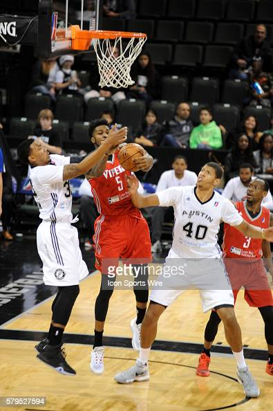 Austin Spurs guard Orlando Johnson battles Chris Walker for a loose ball as forward Walter Tavares looks on during the Austin Spurs 113 107 loss to...