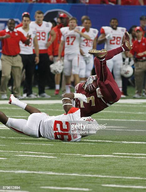 Brandon Wilson takes Jesus Wilson during the Florida State Seminoles v Houston Cougars in the ChickfilA Peach Bowl at the Georgia Dome in Atlanta GA