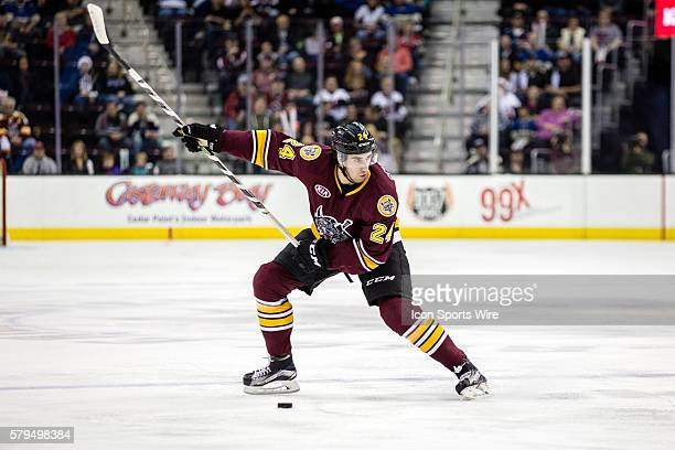 Chicago Wolves D Jordan Schmaltz winds up to take a shot during the first period of the AHL hockey game between the Chicago Wolves and Lake Erie...