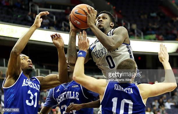 Georgetown Hoyas guard LJ Peak in action against North CarolinaAsheville Bulldogs forward Sam Hughes North CarolinaAsheville Bulldogs guard Dylan...