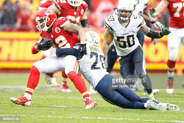 Kansas City Chiefs wide receiver Albert Wilson is tackled by San Diego Chargers cornerback Patrick Robinson during the game between the San Diego...