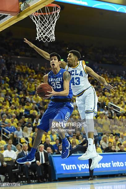 Kentucky Derek Willis puts up a shot around UCLA Jonah Bolden during an NCAA basketball game between the Kentucky Wildcats and the UCLA Bruins at...