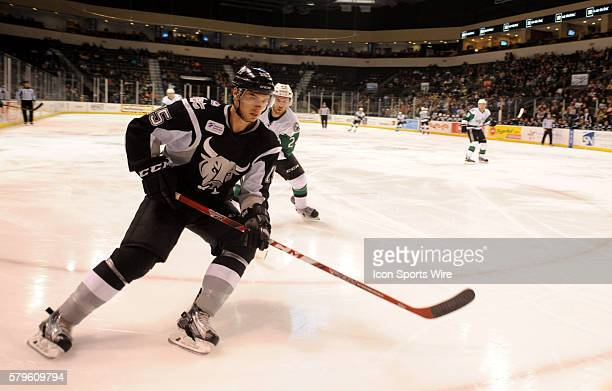 San Antonio Rampage player Duncan Siemens chases down a loose puck during 5 4 win over the Texas Stars at the Cedar Park Center in Cedar Park TX