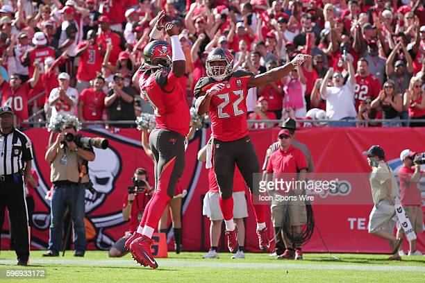 Tampa Bay Buccaneers running back Doug Martin celebrates with Tampa Bay Buccaneers quarterback Jameis Winston after running for a touchdown in the...