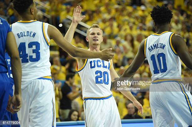 UCLA Bryce Alford celebrates with UCLA Jonah Bolden and UCLA Isaac Hamilton after a foul call during an NCAA basketball game between the Kentucky...