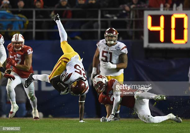 USC Ronald Jones II gets flipped into the air by Wisconsin Tanner McEvoy during the Holiday Bowl game between the USC Trojans and the Wisconsin...