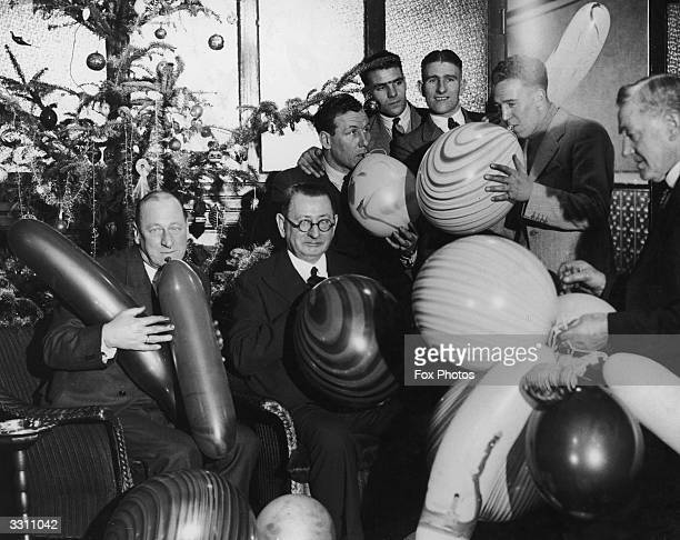 Directors and players of the Liverpool football club preparing for their Christmas party