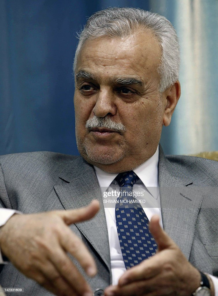 --A December 25, 2011 file photo shows Iraqi Vice President Tareq al-Hashemi, who is charged with running a death squad, speaks during an interview with AFP in Qalachwalan, 50 kms north of Sulaimaniyah. Iraq said on April 2, 2012, that Qatar hosting fugitive Vice President Tareq al-Hashemi was 'unacceptable' and called on Doha to hand him over, a demand he said was unconstitutional after talks with Qatar's emir. AFP PHOTO/SHWAN MOHAMMED