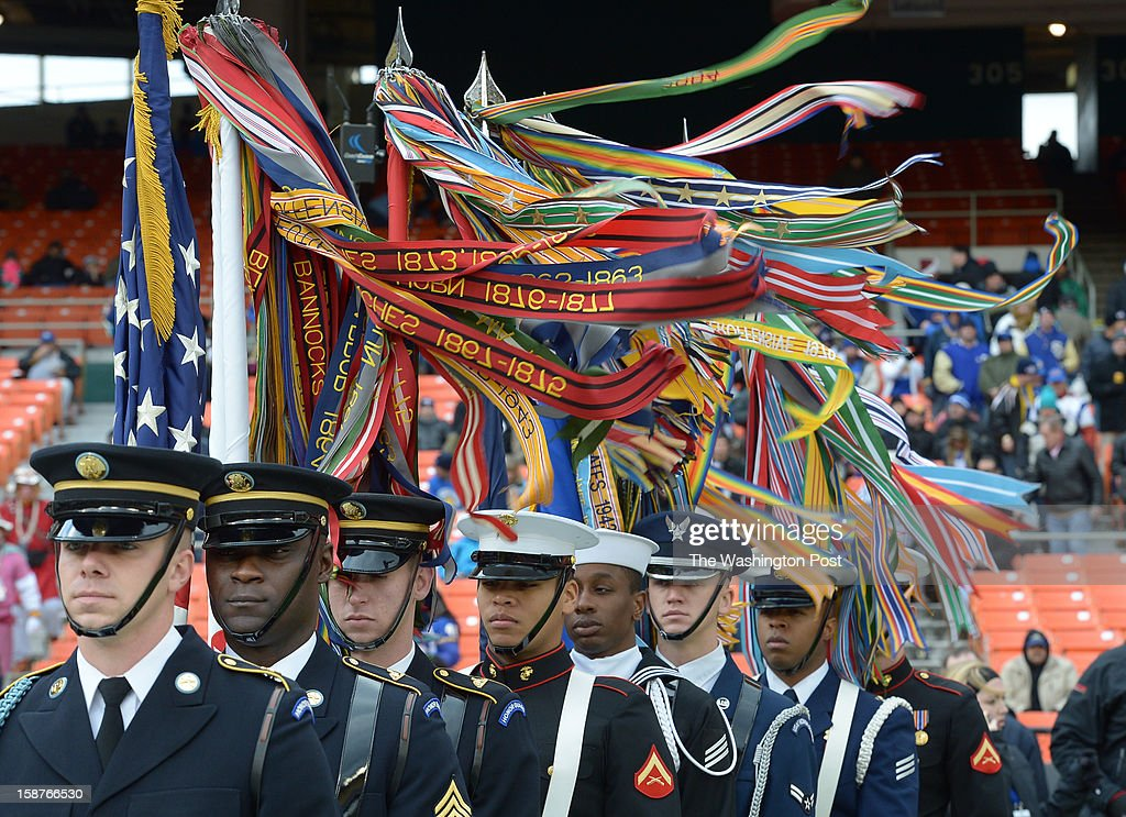 High winds swirl the Campaign streamers at the start of the Military bowl as members of the joint forces color guard take the field prior to action between San Jose State and Bowling Green on December 27, 2012 in Washington, DC