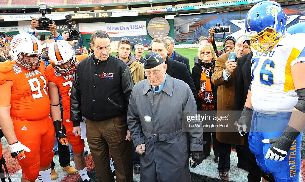 Mayor Vincent C. Gray watches as Medal of Honor recipient Hershal 'Woody' Williams tosses the coin at the start of the Military Bowl between San Jose State and Bowling Green on December 27, 2012 in Washington, DC