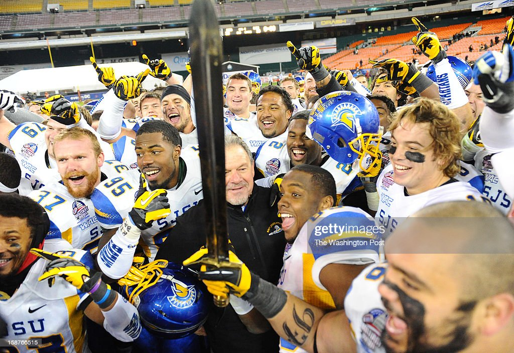 Members of the San Jose State Spartans surround San Jose State head coach interim head coach Kent Baeron following their 29-20 victory over Bowling Green December 27, 2012 in Washington, DC